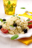 Couscous. With mozzarella, tomatoes, mint and black olives Royalty Free Stock Photography