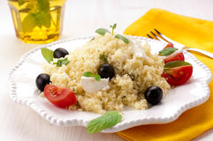 Couscous. With mozzarella, tomatoes, mint and black olives Stock Photos
