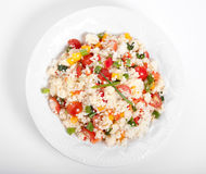Couscous. Salad  peppers,tomatoes spring onion for the garnish. top view Royalty Free Stock Photography