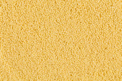 Couscous as background texture Royalty Free Stock Photo
