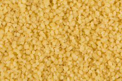 Couscous as background texture Royalty Free Stock Photos