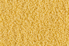 Couscous as background texture Stock Photography