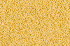 Couscous as background texture Stock Photo