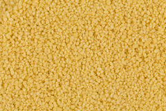 Couscous as background texture Stock Images