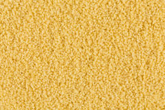Couscous as background texture Royalty Free Stock Images