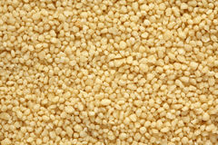 Couscous. Background. Full frame. Close-up Stock Photography