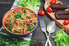 Couscous in a blue ceramic bowl Stock Photo