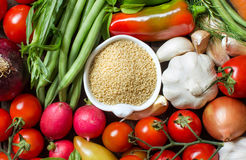 CousCous in a bowl and fresh vegetables. Closeup Royalty Free Stock Photography