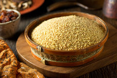 Couscous. A bowl of raw organic couscous Royalty Free Stock Photo