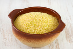 Couscous in brown bowl Stock Images