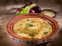 Couscous cake with onions stock photography