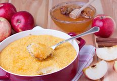 Couscous casserole with apples, honey and cinnamon. Couscous casserole kodafa with apples, honey and cinnamon on wooden background Royalty Free Stock Photo