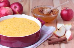 Couscous casserole with apples, honey and cinnamon. Couscous casserole kodafa with apples, honey and cinnamon on wooden background Royalty Free Stock Photography