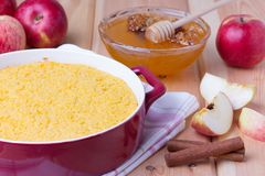 Couscous casserole with apples, honey and cinnamon. Couscous casserole kodafa with apples, honey and cinnamon on wooden background Stock Images