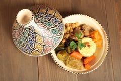 Couscous in a clay pot Stock Photos