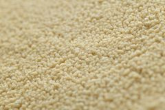 Couscous closeup. Bulgur. Uncooked, natural, diet, raw for traditional Middle East and Mediterranean cuisine, dish Stock Image