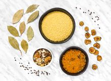 Couscous and cooking ingredients on marble background royalty free stock photo