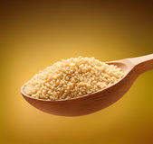 Couscous (cooking) in a wooden spoon Royalty Free Stock Image