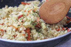 Couscous. Cosucous cooked with vegetables, olives, carots, and spice Royalty Free Stock Photography