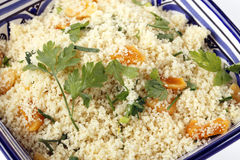 Couscous with dried apricots and parsley Stock Photos