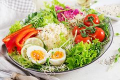 Couscous, egg and vegetables bowl. Healthy, diet, vegetarian food concept. Vegetarian buddha bowl stock photography