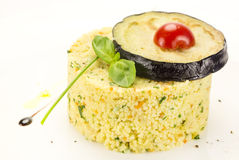 Couscous. Embellished with eggplant and tomato Stock Photo