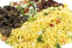 Couscous Farofa. Brazilian northeast Food - Couscous Farofa with dry meat and vinaigrette salad Stock Photo