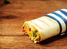 Couscous Filled Grilled Burrito Wrap on Wood Table Stock Images