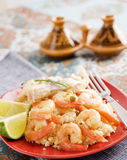 Couscous fish. Fish  and shrimps with couscous, garnished with  carrots and green peas Stock Images