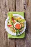 Couscous and fried egg Stock Images