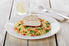 Couscous with green peas and chicken fillet Stock Image