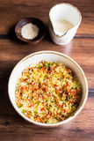Couscous with green and red bell pepper, olive oil and sesame seeds in a bowl Royalty Free Stock Image