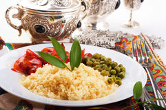 Couscous with green-stuffs. And Arabic tableware, east kitchen Stock Photography