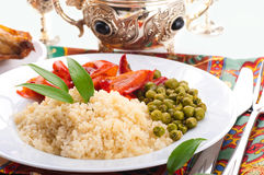 Couscous with green-stuffs. And Arabic tableware, east kitchen Royalty Free Stock Images