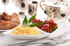Couscous with green-stuffs and Arabic tableware,. East kitchen Stock Image
