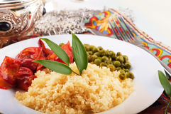 Couscous with green-stuffs and Arabic tableware. East kitchen Royalty Free Stock Photo