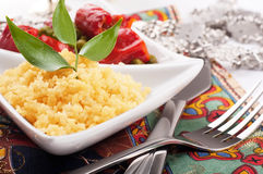 Couscous with green-stuffs and east tableware. Couscous with green-stuffs and Arabic tableware, east kitchen Royalty Free Stock Photos