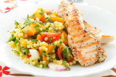 Couscous with grilled chicken Stock Photography