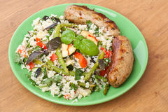 Couscous with Grilled Sausages Royalty Free Stock Photo