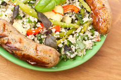 Couscous with Grilled Sausages Royalty Free Stock Image