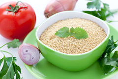 Couscous and ingredients Stock Photos