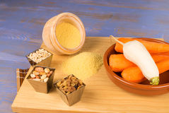 Couscous ingredients. Some couscous ingredients on a wooden chopping board royalty free stock image