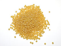 Couscous or kuskus. A basic ingredient for a medeterranean dish made of farine and wheat on a white background Stock Photos