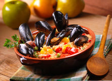 Couscous with mussels in earthenware bowl Stock Photography