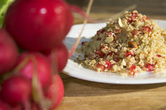 Couscous with pomegranate and walnuts Stock Images