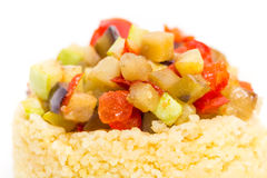 Couscous porridge with baked vegetables. Stock Images