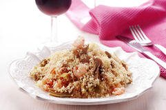 Couscous with prawns. And artichoke Stock Photo