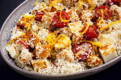Couscous with Pumpkin Tomatoes and Halloumi  Stock Image