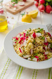 Couscous with radishes and herbs. Topped herbs and olive oil, simple but delicious vegetarian food Stock Photography