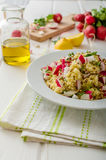 Couscous with radishes and herbs. Topped herbs and olive oil, simple but delicious vegetarian food Royalty Free Stock Images